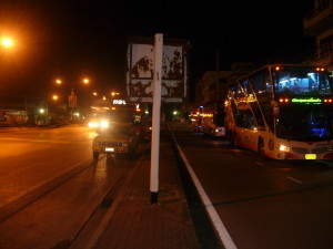 A long distance bus takes a break during a journey through the night in Thailand