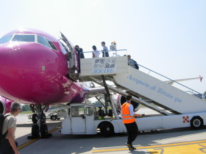 Passengers board a  colourful plane at Treviso Airport