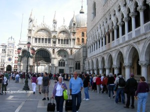 Tourists queue up to get into the bell tower (out of frame in the left) at St Mark's Square in Venice