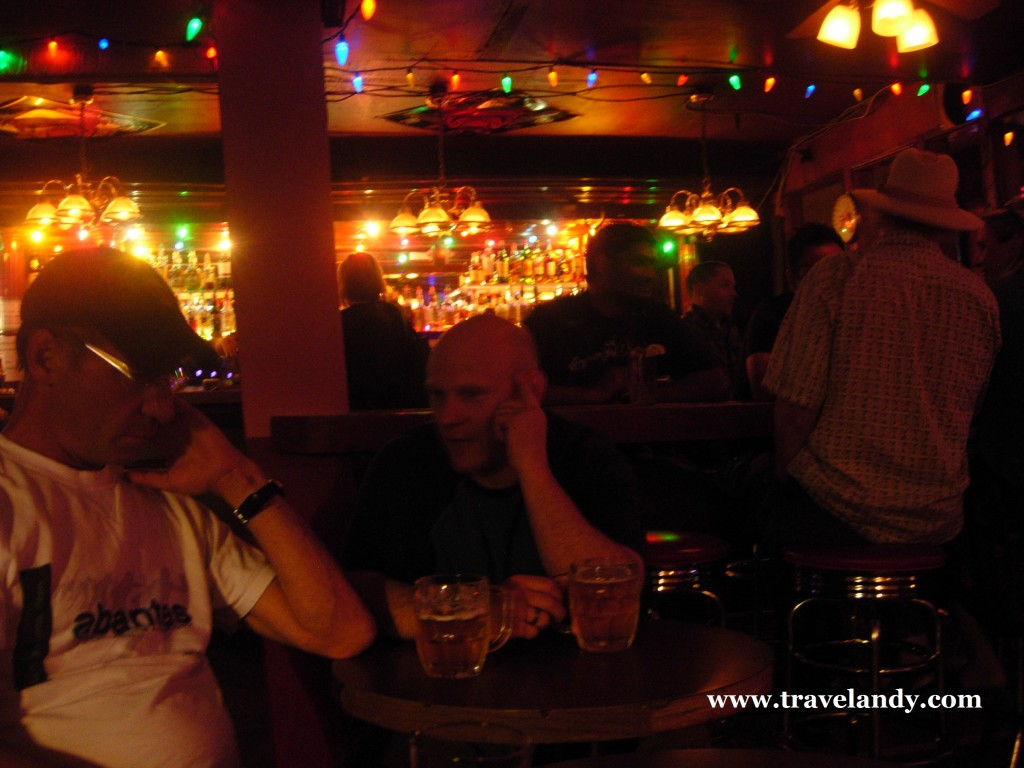 "Two locals enjoy a beer at The Pitt. The man on the left was the one who said, ""Welcome to Dawson City."""