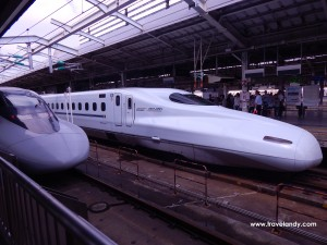 Shinkansen trains at a station