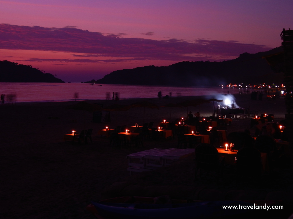 Palolem beach at dusk. The cafes set up these tables so that you can sit right on the beach and have dinner