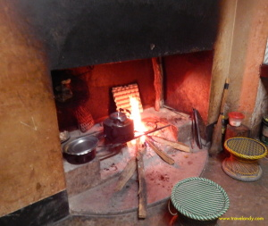 A warm fire burns in K's kitchen