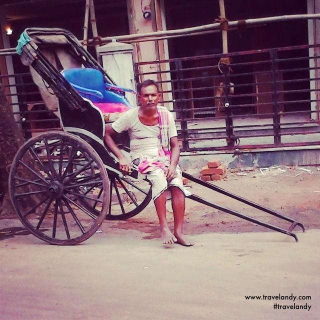 A hand-rickshaw puller waits for passengers at Sudder Street in Kolkata