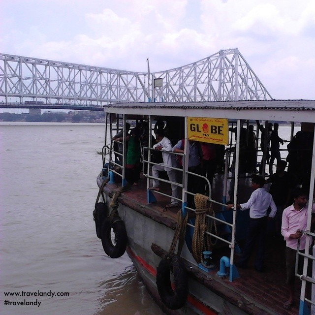 Ferry on the Hooghly river in Kolkata. Tin the background is the Howrah bridge, the busiest cantilever bridge in the world