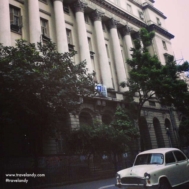 Kolkata has beautiful colonial buildings. And there's the iconic Ambassador car is also in the frame
