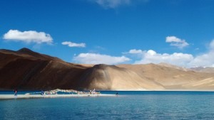 Pangong under a mostly blue sky.