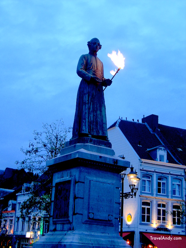 The statue at Markt Square with a flaming torch