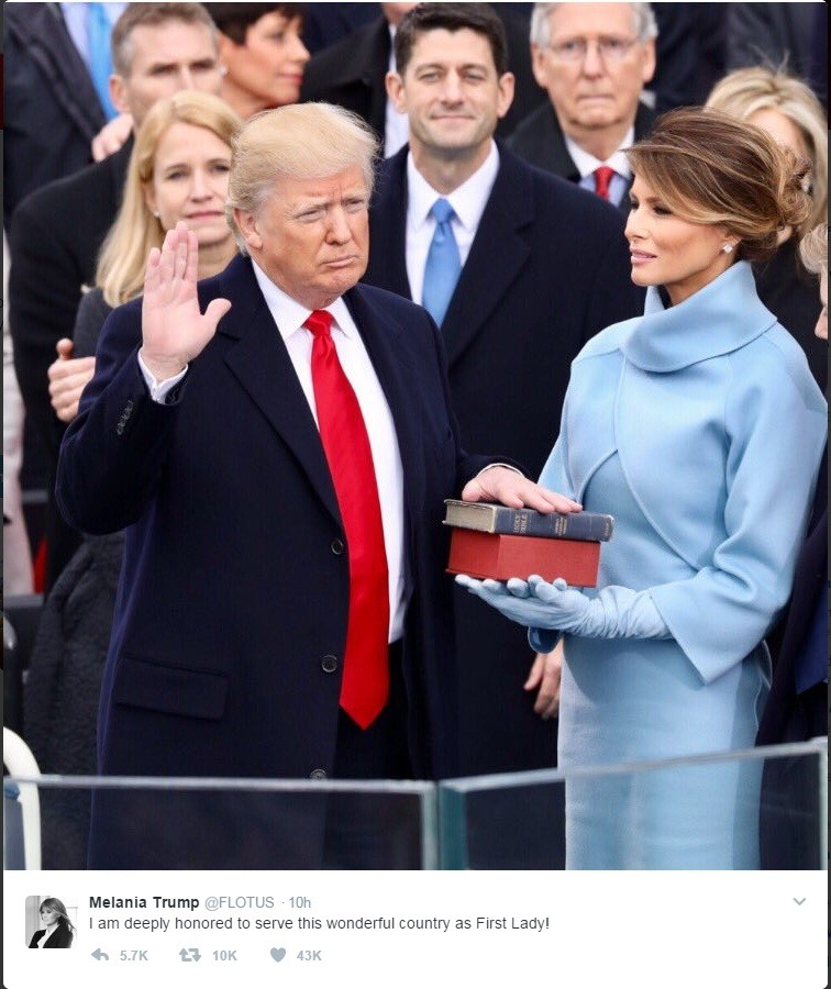 Melania hold the Bible while husband Donald Trump takes oath as US President. (Picture: twitter.com/FLOTUS)