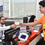 Dubai stamps passports with smiley on Happiness Day